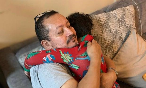 Asmel Matamoros hugging one of his grandchildren