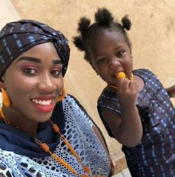 Adja Diol with her daughter, Khadija.
